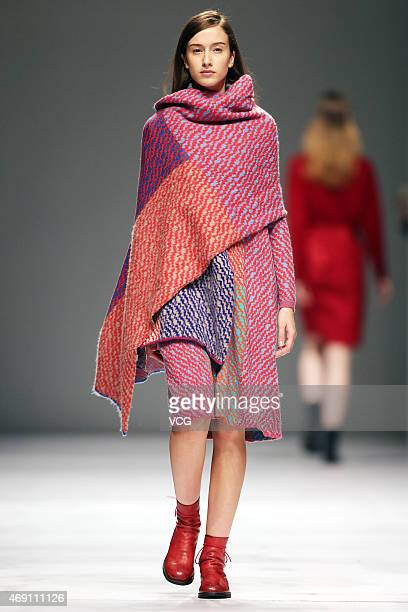 Model walks the runway during the Decoster show as part of Shanghai Fashion Week Autumn/Winter Collection on April 9, 2015 in Shanghai, China.