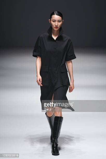 Model walks the runway during the DEJIN collection show by Chinese designer Li Zhou on day seven of China Fashion Week A/W 2021/2022 at 751D.PARK on...