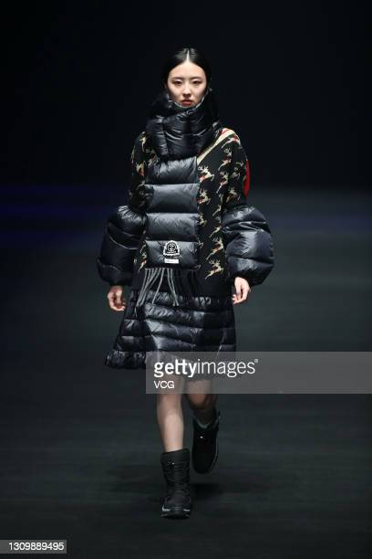 Model walks the runway during the DEMAINZ collection show by designer Chen Zhihua on day six of China Fashion Week A/W 2021/2022 at 751D.PARK on...