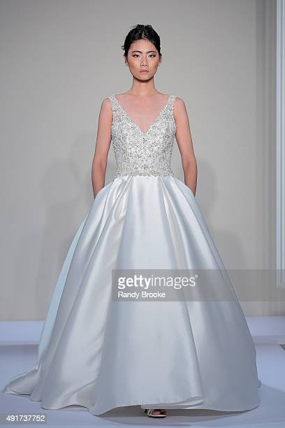 Model walks the runway during the Dennis Basso For Kleinfeld Bridal Fall/Winter 2016 Runway Show at Kleinfeld on October 7, 2015 in New York City.