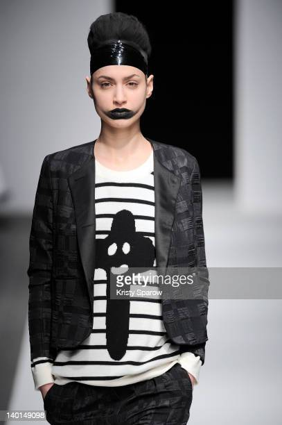 A model walks the runway during the Devastee ReadyToWear Fall/Winter 2012/13 show as part of Paris Fashion Week at Alexandre III Port des Champs...