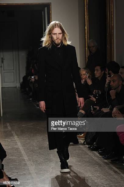 A model walks the runway during the DGnak by KangD show as a part of Milan Fashion Week Menswear Autumn/Winter 2014 on January 14 2014 in Milan Italy