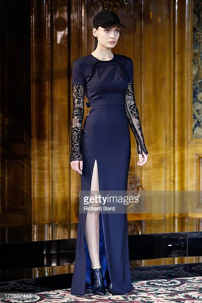 A model walks the runway during the Didit Hediprasetyo show as part of Paris Fashion Week HauteCouture Fall/Winter 20132014 at Hotel Le Bristol on...