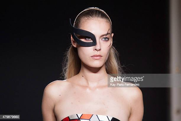 A model walks the runway during the Didit show as part of Paris Fashion Week Haute Couture Fall/Winter 2015/2016 on July 8 2015 in Paris France