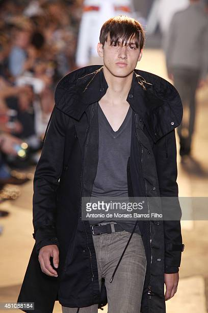 A model walks the runway during the Diesel Black Gold show as a part of Milan Fashion Week Menswear Spring/Summer 2015 on June 23 2014 in Milan Italy