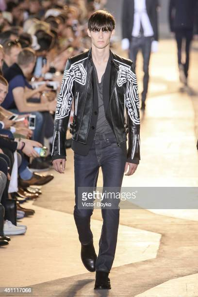 A model walks the runway during the Diesel Black Gold show as part of Milan Fashion Week Menswear Spring/Summer 2015 on June 23 2014 in Milan Italy