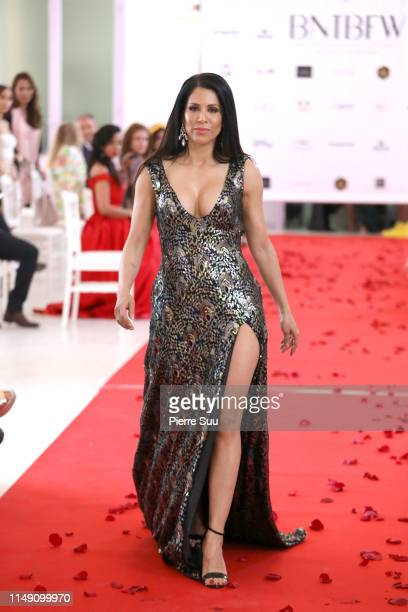 A model walks the runway during the DIIT show at BNTB Cannes Fashion Week on May 14 2019 in Cannes France