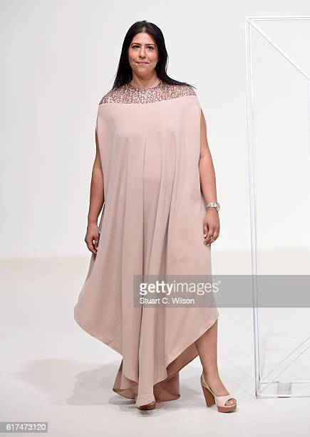 A model walks the runway during the Dima Ayad presentation at Fashion Forward Spring/Summer 2017 held at the Dubai Design District on October 23 2016...