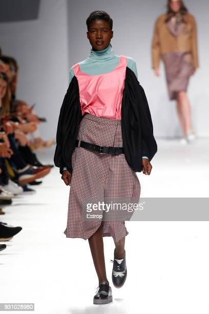 A model walks the runway during the Dino Alves show as part of the Lisboa Fashion Week 'Moda Lisboa' 2018 on March 11 2018 in Lisbon Portugal