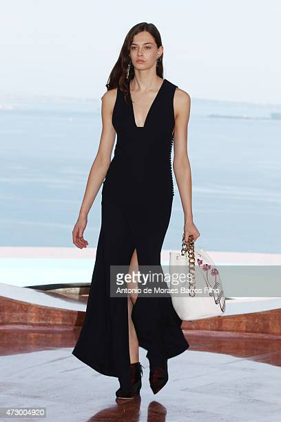 A model walks the runway during the Dior Croisiere 2016 show at 'Palais Bulle Bubble Palace' on May 11 2015 in French Riviera France