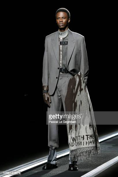A model walks the runway during the Dior Homme Menswear Fall/Winter 20192020 show as part of Paris Fashion Week on January 18 2019 in Paris France