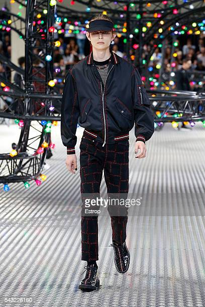 Model walks the runway during the Dior Homme Menswear Spring/Summer 2017 show designed by Kris Van Assche as part of Paris Fashion Week on June 25,...
