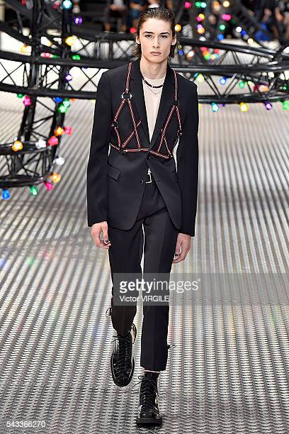 A model walks the runway during the Dior Homme Menswear Spring/Summer 2017 show as part of Paris Fashion Week on June 25 2016 in Paris France
