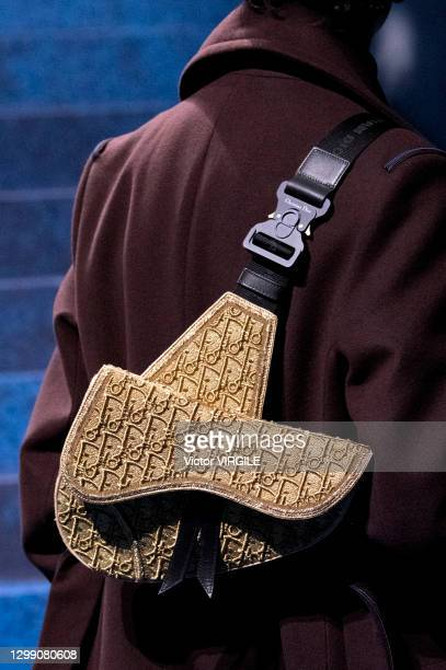 Model walks the runway during the Dior Hommes Ready to Wear Fall/Winter 2021-2022 fashion show as part of the Paris Men Fashion Week on January 20,...