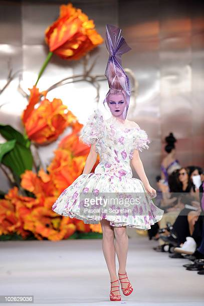 A model walks the runway during the Dior show as part of the Paris Haute Couture Fashion Week Fall/Winter 2011 at Musee Rodin on July 5 2010 in Paris...