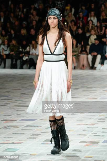A model walks the runway during the Dior show as part of the Paris Fashion Week Womenswear Fall/Winter 2020/2021 on February 25 2020 in Paris France