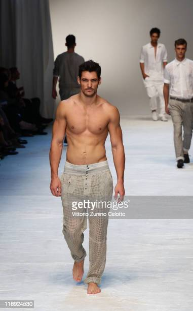 A model walks the runway during the Dolce Gabbana fashion show as part of Milan Fashion Week Menswear Spring/Summer 2012 on June 18 2011 in Milan...