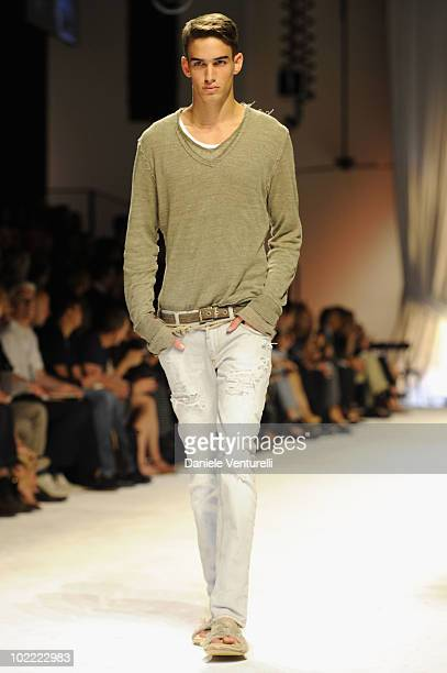 A model walks the runway during the Dolce Gabbana Milan Menswear Spring/Summer 2011 show on June 19 2010 in Milan Italy