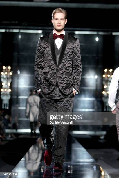 A model walks the runway during the Dolce Gabbana show as part of Milan Fashion Week Autumn/Winter 2009/10 Menswear on January 17 2009 in Milan Italy