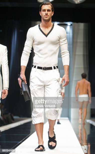 A model walks the runway during the Dolce Gabbana show as part of Milan Menswear Fashion Week Spring/Summer 2010 on June 20 2009 in Milan Italy