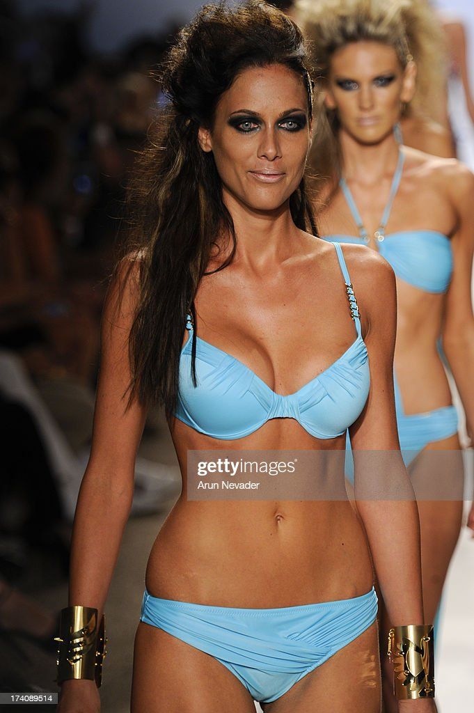 A model walks the runway during the Dolores Cortes fashion show at Mercedes-Benz Fashion Week Swim 2014 - Runway at Raleigh Hotel on July 19, 2013 in Miami Beach, Florida.