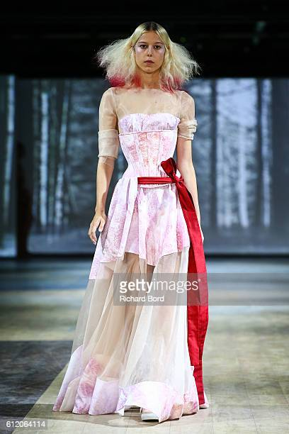 A model walks the runway during the Dorhout Mees show as part of the Paris Fashion Week Womenswear Spring/Summer 2017 on October 2 2016 in Paris...