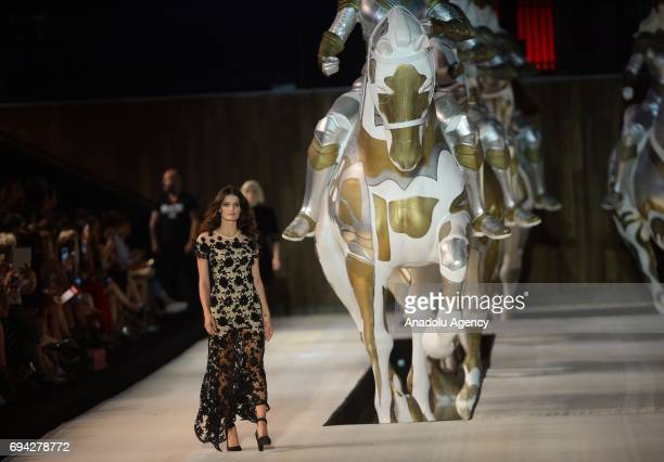 Model walks the runway during the Dosso Dossi Fashion Show in Antalya, Turkey on June 09, 2017.