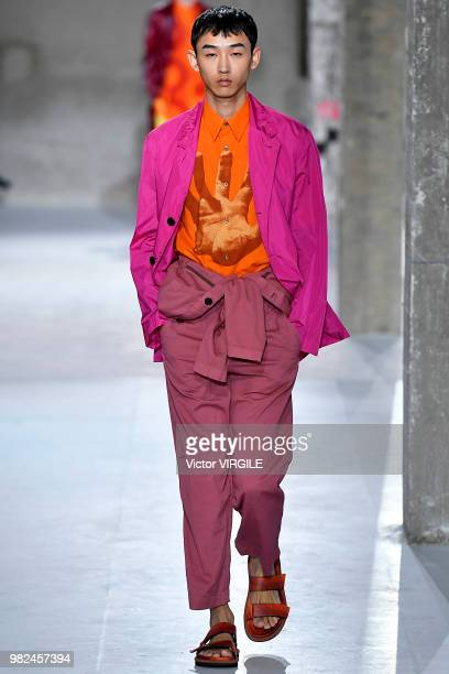 A model walks the runway during the Dries Van Noten Menswear Spring/Summer 2019 fashion show as part of Paris Fashion Week on June 21 2018 in Paris...