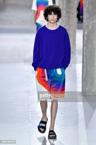 A model walks the runway during the Dries Van Noten Menswear Spring/Summer 2019 show as part of Paris Fashion Week on June 21 2018 in Paris France