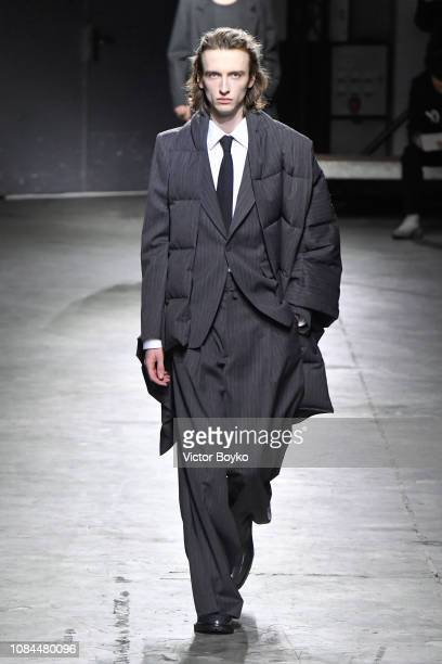 A model walks the runway during the Dries Van Noten Menswear Fall/Winter 20192020 show as part of Paris Fashion Week on January 17 2019 in Paris...