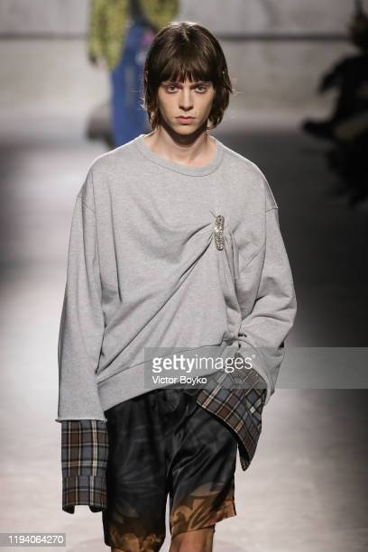 Model walks the runway during the Dries Van Noten Menswear Fall/Winter 2020-2021 show as part of Paris Fashion Week on January 16, 2020 in Paris,...