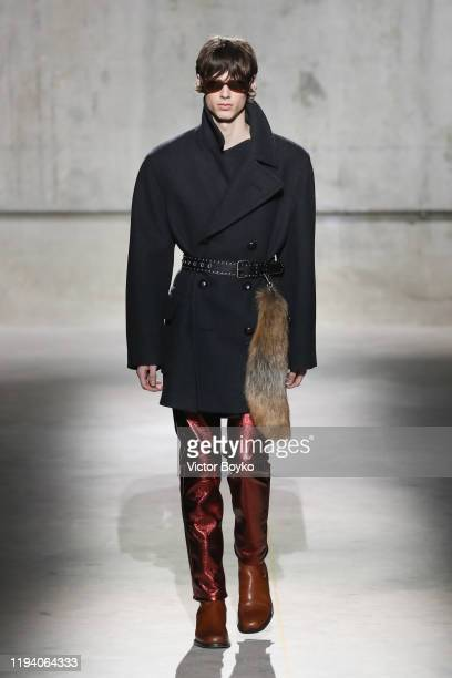 Model walks the runway during the Dries Van Noten Menswear Fall/Winter 2020-2021 show as part of Paris Fashion Week on January 16, 2020 in Paris,...