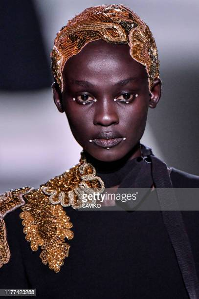 Model walks the runway during the Dries Van Noten ready to Wear Spring/Summer 2020 fashion show as part of Paris Fashion Week on September 25, 2019...