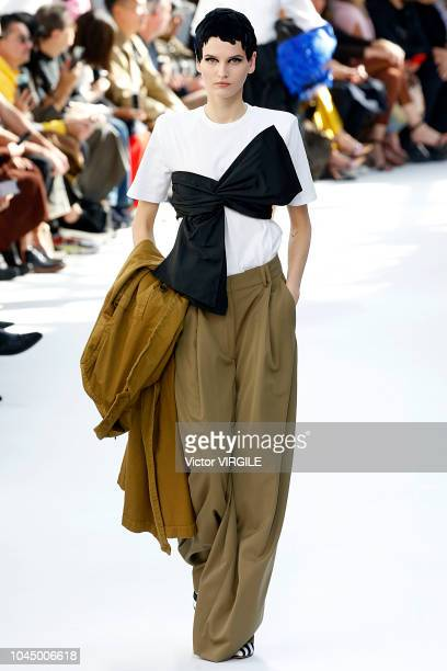 A model walks the runway during the Dries Van Noten Ready to Wear fashion show as part of the Paris Fashion Week Womenswear Spring/Summer 2019 on...