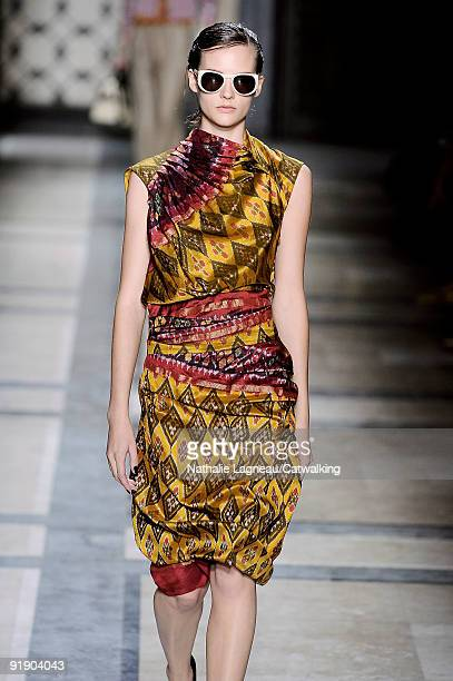 A model walks the runway during the Dries Van Noten Ready To Wear show as part of the Paris Womenswear Fashion Week Spring/Summer 2010 at 7 Place...