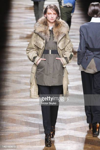 A model walks the runway during the Dries Van Noten ReadyToWear Fall/Winter 2012 show as part of Paris Fashion Week on February 29 2012 in Paris...