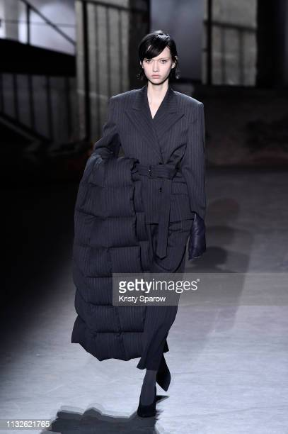 A model walks the runway during the Dries Van Noten show as part of Paris Fashion Week Womenswear Fall/Winter 2019/2020 on February 27 2019 in Paris...