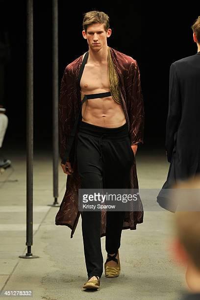 Model walks the runway during the Dries Van Noten show as part of Paris Fashion Week Menswear Spring/Summer 2015 on June 26, 2014 in Paris, France.