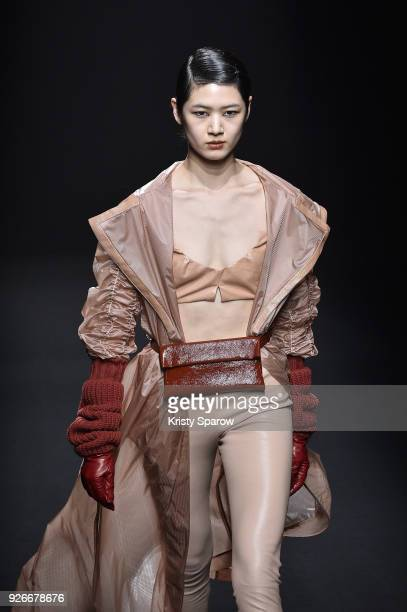 A model walks the runway during the DROMe show as part of Paris Fashion Week Womenswear Fall/Winter 2018/2019 on March 3 2018 in Paris France
