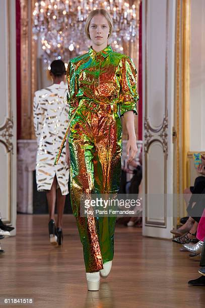 A model walks the runway during the DroMe show as part of the Paris Fashion Week Womenswear Spring/Summer 2017 on October 1 2016 in Paris France