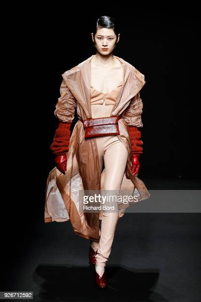 A model walks the runway during the Drome show as part of the Paris Fashion Week Womenswear Fall/Winter 2018/2019 on March 3 2018 in Paris France