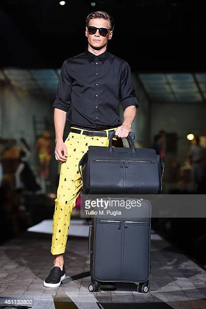 A model walks the runway during the DSquared2 show as part of Milan Fashion Week Menswear Spring/Summer 2015 on June 24 2014 in Milan Italy