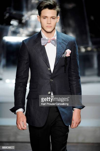 A model walks the runway during the Dunhill fashion show at Paris Fashion Week Menswear Spring/Summer 2010 at Maison de l'Architecture on June 27...