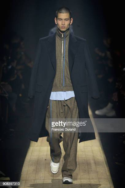 A model walks the runway during the Dunhill London Menswear Fall/Winter 20182019 show as part of Paris Fashion Week on January 21 2018 in Paris France