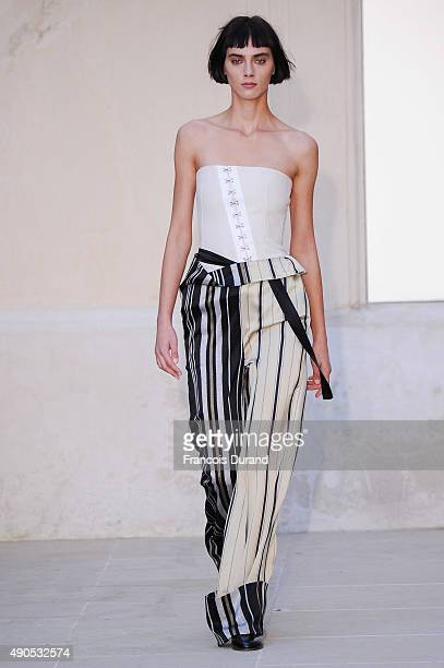 A model walks the runway during the Each X Other show as part of the Paris Fashion Week Womenswear Spring/Summer 2016 on September 29 2015 in Paris...