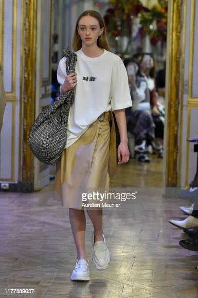 A model walks the runway during the Each x Other Womenswear Spring/Summer 2020 show as part of Paris Fashion Week on September 29 2019 in Paris France