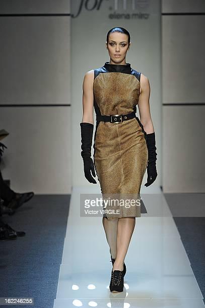 A model walks the runway during the Elena Miro Ready to Wear Fall/Winter 20132014 show as part of the Milan Fashion Week Womenswear Fall/Winter...