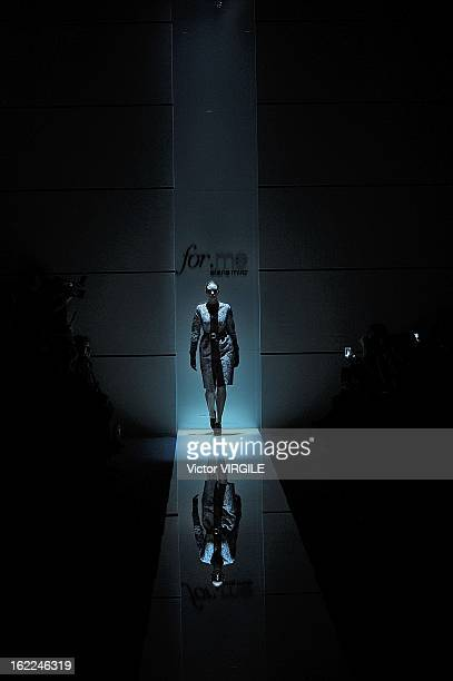 A model walks the runway during the Elena Miro Ready to Wear Fall/Winter 20132014 show as part of the Milan Fashion Week Womenswear Fall/Winter...