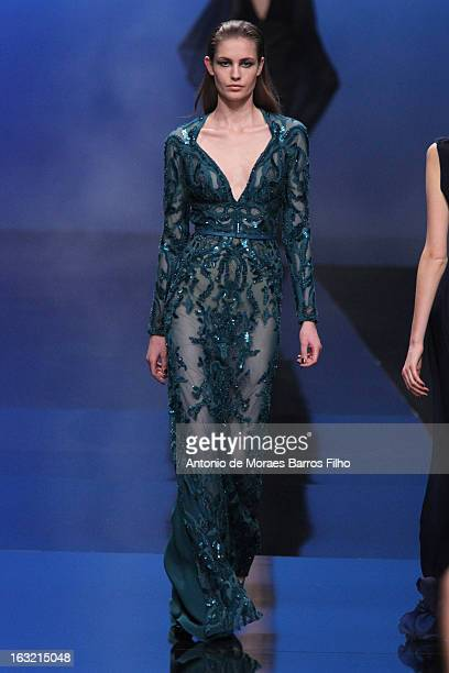 A model walks the runway during the Elie Saab Fall/Winter 2013 ReadytoWear show as part of Paris Fashion Week on March 6 2013 in Paris France