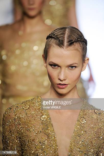 A model walks the runway during the Elie Saab Haute Couture Fall Winter 20122013 show as part of the Paris Haute couture Week on July 4 2012 in Paris...